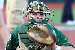 11 August 2012: Catcher Trey Manz warms up during a Frontier League Baseball game between the River City Rascals and the Normal CornBelters at Corn Crib Stadium on the campus of Heartland Community College in Normal Illinois.  The CornBelters take this game in 9 innings 7 - 2 with a 5 run 2nd inning.