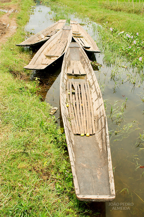 Canoes anchored at at village in the middle of Inle lake