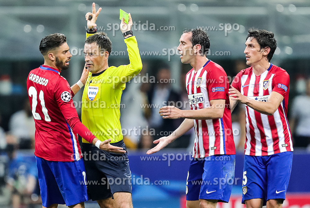 Yannick Carrasco of Atlético, Referee Mark Clattenburg (ENG), Diego Godín of Atlético, Stefan Savić of Atlético during football match between Real Madrid (ESP) and Atlético de Madrid (ESP) in Final of UEFA Champions League 2016, on May 28, 2016 in San Siro Stadium, Milan, Italy. Photo by Vid Ponikvar / Sportida