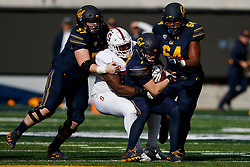 BERKELEY, CA - DECEMBER 01: Quarterback Chase Garbers #7 of the California Golden Bears is sacked by defensive tackle Michael Williams #57 of the Stanford Cardinal during the first quarter at California Memorial Stadium on December 1, 2018 in Berkeley, California. (Photo by Jason O. Watson/Getty Images) *** Local Caption *** Chase Garbers; Michael Williams