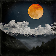 Alpine landscape at night with a full moon in orange - photo manipulation<br />