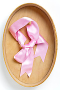 lwooden oval box with pink gift rap ribbon bow