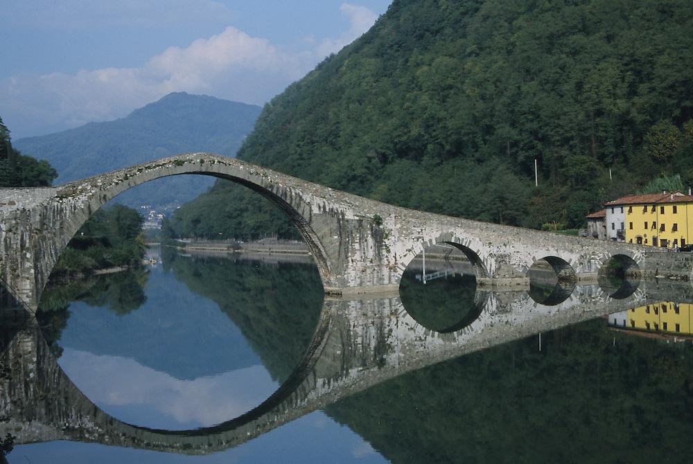 Europe, Italy, Tuscany, historic stone bridge reflected in river