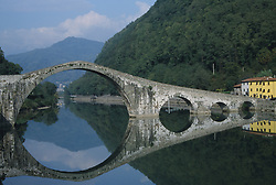 Europe, Italy, Tuscany, historic stone bridge reflected in river