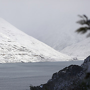 The TSS Earnslaw, A vintage steam ship, sailing on Lake Wakatipu after the biggest snow storm in New Zealand in the past 50 years. Queenstown, New Zealand, 16th August 2011. Photo Tim Clayton