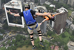 September 29, 2017 - Kuala Lumpur, Malaysia - Base jumpers leaps from the 300-metre high open deck at Kuala Lumpur Tower during the Kuala Lumpur Tower Jump 2017 on Friday, September 29 in Kuala Lumpur, Malaysia. 120 professional base jumpers from 24 countries including Australia, Austria, Belgium, Brazil, Canada, Finland, Denmark, France, Ireland, Iran, Germany, Italy, Japan, Kuwait, Luxembourg, Netherland, New Zealand, Norway, Russia, South Africa, Switzerland, United States of America and Inited Kingdom..The event will take event from 30th September to 2nd October. (Credit Image: © Chris Jung/NurPhoto via ZUMA Press)