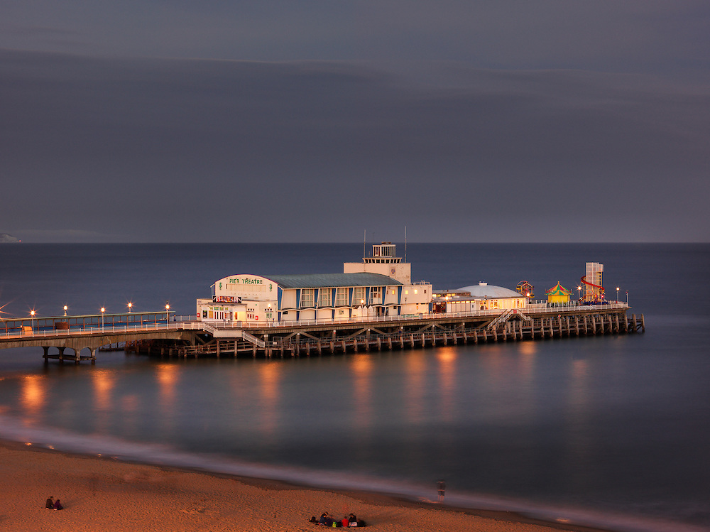Dusk lighting creates moody ambience on the North Side of the Bournemouth Pier in the United Kingdom