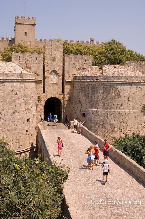 Toruists at the D'Amboise Gate and city walls around RhodesTown, Rhodes,<br /> Dodecanese Islands, Greece