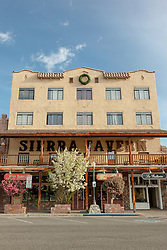 """""""Downtown Truckee 15"""" - Photograph of the Sierra Tavern in historic Downtown Truckee, California with blossoming crabapple trees in the foreground."""