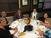Volunteer students and professors enjoying a meal of the harvest provided by Aviands