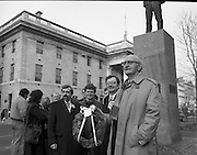 Workers Party Commemoration Of James Larkin.(R50)..1987..07.02.1987..02.07.1987..7th February 1987..A wreath laying ceremony was held today at the memorial for Trade Union leader,James Larkin. The ceremony was conducted the Workers' Party. Mr Tomás McGiolla, leader of the Workers'Party, laid the wreath at the memorial in O'Connell Street, Dublin. The ceremony was held to commomerate the 40th anniversary of the death of James Larkin...Image shows Mr McGiolla holding wreath at the monument in O'Connell Street. Include in the photograph are Clrs, E Byrne, Eamon Gilmore and Pat Rabitte.