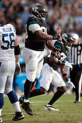 Jacksonville Jaguars defensive tackle Marcell Dareus (99) leaps and celebrates after stopping a fourth down play late in the fourth quarter during the NFL week 13 regular season football game against the Indianapolis Colts on Sunday, Dec. 2, 2018 in Jacksonville, Fla. The Jaguars won the game in a 6-0 shutout. (©Paul Anthony Spinelli)
