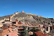 General view of the village with the Ramparts in the background, Albarracin, Teruel, Spain, on February 13, 2006, pictured in the afternoon. Albarracin, a beautiful village with National Monument status overlooking the Guadalivar River, lies 28 km from Teruel, in the National Park in the Montes Universales. It is on the border of three Spanish Kingdoms: Castille, Aragon and Valencia, has been occupied for hundreds of years and is known as the Eagles` Nest because it  is built on a steep outcrop of rock surrounded by a deep gorge, a natural defence. Its buildings show  Moorish influence and even the name may derive from  the Berber clan Banu Razin who settled in the area during the 9th century. Picture by Manuel Cohen.