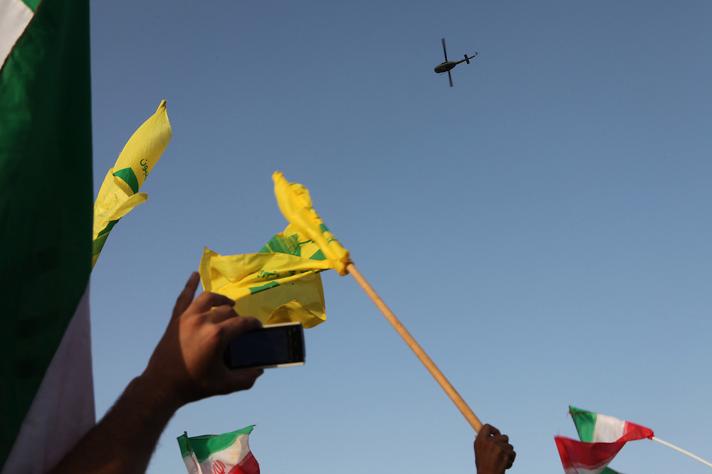 On the second and final day of his visit to Lebanon, Iranian President Mahmoud Ahmadinejad traveled to the southern town of Bint Jbeil. There a Hizballah-organized rally was held to welcome Ahmadinejad to the south Lebanon, an area where Hizballah is widely supported. Tens of thousands gathered for hours holding flags of Iran, Hizballah, Lebanon and other political parties, cheering the Iranian president as he arrived by helicopter from Beirut. ///A lebanese army helicopter that delivered Iranian President Mahmoud Ahmadinejad to South Lebanon from Beirut.