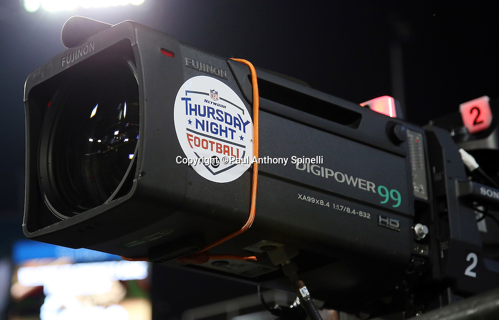 A sideline television camera takes video of the Tennessee Titans 2015 week 11 regular season NFL football game against the Jacksonville Jaguars on Thursday, Nov. 19, 2015 in Jacksonville, Fla. The Jaguars won the game 19-13. (©Paul Anthony Spinelli)