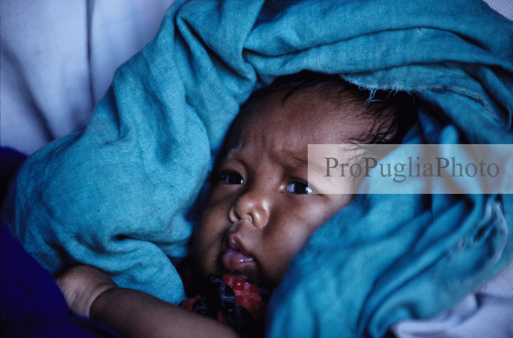 A three weeks old Nepali girl. She was born on the 1st of February 2005, the day of the Royal takeover...