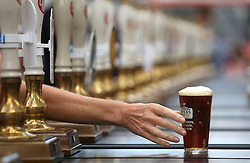 Embargoed to 0001 Tuesday October 11 File photo dated 09/08/16 of a pint of real ale being passed across a bar as a leading pub group has added its voice to calls for the Government to negotiate a free trade deal with the EU as part of the Brexit talks.