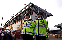 Photo: Daniel Hambury.<br />West Ham Utd v West Bromwich Albion. The Barclays Premiership. 05/11/2005.<br />Two police infront of the Bobby Moore stand at Upton Park ahead of the match as the Home Office announces a drop of 10% in football related arrests.