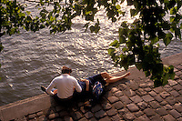 couple on the banks of the Seine, Ile St. Louis, Paris