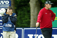Photograph: Scott Heavey<br />Volvo PGA Championship At Wentworth Club. 23/05/2003.<br />Thomas Bjorn and caddie try to relax after a hard round.