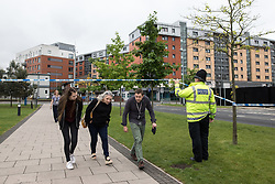 June 2, 2017 - Manchester, Greater Manchester, UK - Manchester , UK . People are evacuated from surrounding buildings as police erect a 100m cordon around Banff Road after a car , which they say is significant in their investigation in to Salman Abedi , is discovered at Devell House , during a visit by the Duke of Cambridge , Prince William , at Royal Manchester Children's Hospital . The prince was meeting patients affected by the murderous bomb attack at an Ariana Grande gig at Manchester Arena on Monday 22nd May  (Credit Image: © Joel Goodman/London News Pictures via ZUMA Wire)