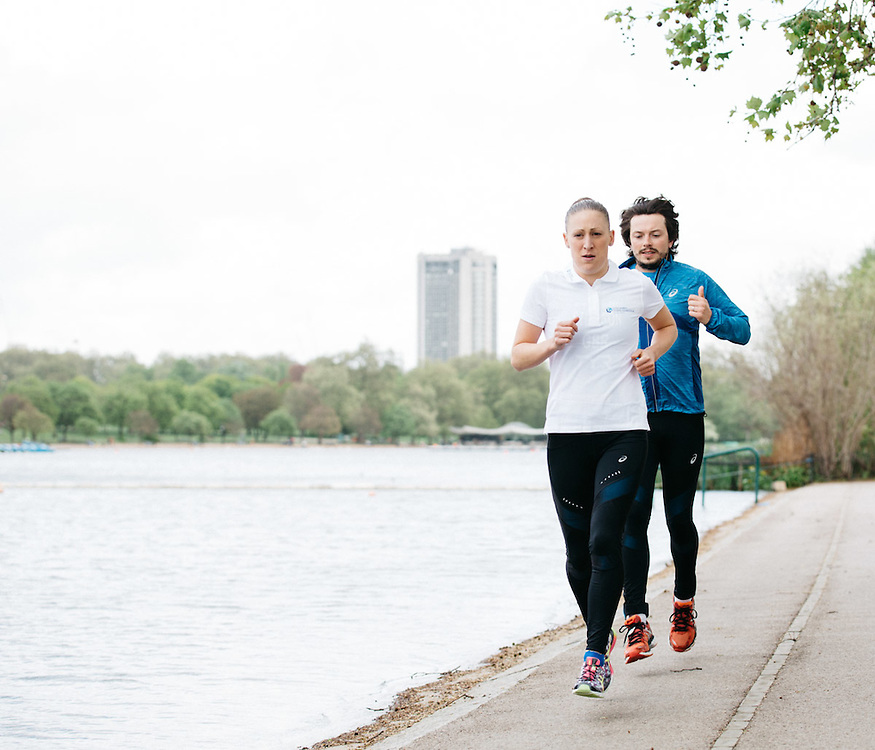 British professional triathlete Jodie Stimpson teaches journalist, Oliver Pickup, running techniques. 6th May 2015, London. Photographed by Greg Funnell for the Financial Times.