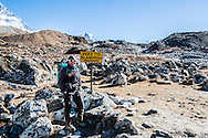 Katie stands next to the sign marking the way to Island Peak.