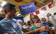 A young girl holds up a Bernie for President sign as people wait for Democratic presidential candidate Sen. Bernie Sanders to arrive at the town hall meeting at Woodbury School in Salem, N.H.,  Sunday, Aug. 23, 2015. (AP Photo/Cheryl Senter)