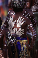 A young boy reasuures his friend with a hand on the back before their dance performance at the Laura Festival held every two years on Cape York, far north Queensland, Australia.