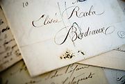 Berkeley, California, June, 2008-Old letters and documents covered with beautiful hand written traditional script. Bordeaux France is prominent.