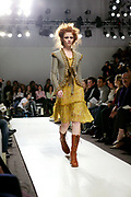 NEW YORK - FEBRUARY 12:  A model walks the runway at the James Coviello fashion show during Olympus Fashion Week at Bryant Park February 12, 2004 in New York City.   (Photo by Matthew Peyton)