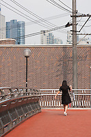 woman on walkway in Shanghai China