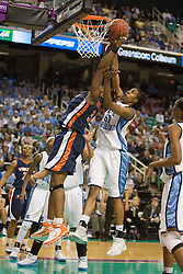 North Carolina forward Jessica Breland (51) blocks a shot by Virginia center Aisha Mohammed (33).  The #4 seed/#25 ranked Virginia Cavaliers women's basketball team fell to the #1 seed/#2 ranked North Carolina Tar Heels 80-65 in the semifinals of the 2008 ACC Women's Basketball Tournament at the Greensboro Coliseum in Greensboro, NC on March 8, 2008.