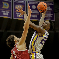 Jan 8, 2019; Baton Rouge, LA, USA; LSU Tigers forward Emmitt Williams (24) shoots over Alabama Crimson Tide forward Alex Reese (3) during the second half at the Maravich Assembly Center. Mandatory Credit: Derick E. Hingle-USA TODAY Sports