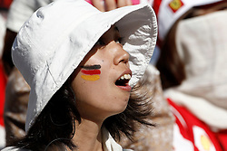 Motorsports / Formula 1: World Championship 2010, GP of Japan, japanese fan of Germany