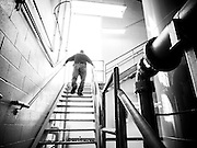 Bill England climbs the stairs to check on the city's two reactors, which hold 2 million of gallons of water in each.