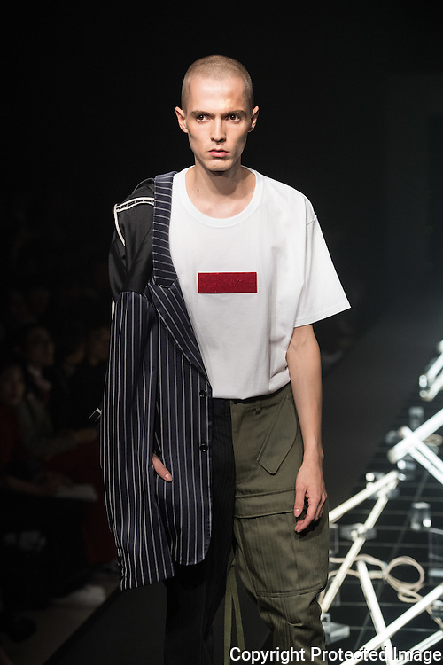 OCTOBER 23: A model  presents the PLASTICTOKYO collection at the Amazon Fashion Week Tokyo's 2017 Spring/Summer show under way at Shibuya Hikarie in Tokyo on Oct. 23, 2016. and other locations through 23rd. Keisuke Imazaki is a Street brand designer based in Tokyo, he translates japanese culture for the world. Nearly 50 fashion brands and companies will hold their shows at several locations through 23rd..23/10/2016-Tokyo, JAPAN