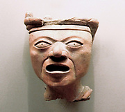 Huaxtec small sculpture of a head from the Gulf of Mexico 900-1450 AD. The Huaxtec culture was conquered and absorbed by the Aztecs. Pre-Columbian Mesoamerican Mythology