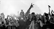 Festival crowd against a barrier at Mudsling Murdoch University W. Australia 1990's.