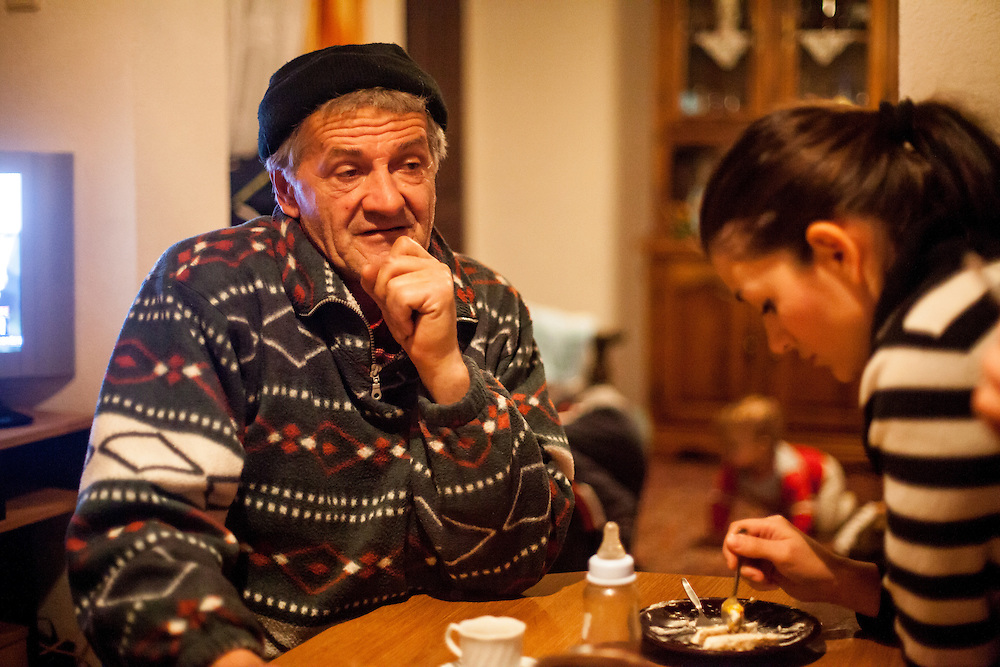 Father Nedzib and sister Elvira of former refugee Elvis Causevic in the kitchen at the families house in Hadžići. The family settled here after the war ended in Bosnia. Hadžići is a town and a municipality located about 20 km south west of Sarajevo city but within the Sarajevo Canton of Bosnia and Herzegovina. According to the census of 2013, Hadžići municipality has a population of 23,891 residents.