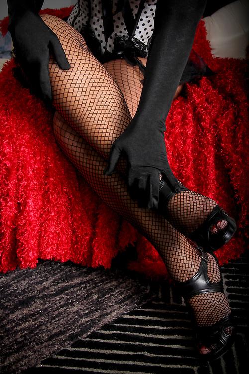 Velvet gloves caress open mesh stockings in a boudoir teaser