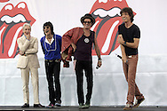 Charlie Watts, Mick Jagger, Ron Woods and Keith Richards of the Rolling Stones pose together following a news conference at which they announced the new concert tour. At the Juilliard School of Music in New York Tuesday 10 May 2005.