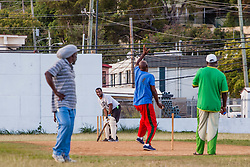 Players of the 40 and over cricket team practice for an upcoming tournament at Addelita Cancryn field.  St. Thomas, USVI.  14 April 2015.  © Aisha-Zakiya Boyd