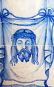Blue and white traditional Azulejo ceramic tiles forming picture of the head of Jesus Christ wearing a crown of thorns, Evora, Alto Alentejo, Portugal, southern Europe