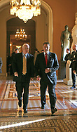 After a meeting with White House officals on detainees at Guantanomo Majority Leader Bill Frist R-TN (on right)  and Senator John McCain R-AZ walk to media stake out position.  The meeting was held at the U.S. Capitol on September 21, 2006.  (left to right:  Representative Duncan Hunter R-CA, Senator John Cornyn R-TX.  Stephen J. Hadley National Security Advisor, Senator John McCain R-AZ,  Senator Lindsey Graham R-SC, Senator John Warner R-VA) Photograph: Dennis Brack