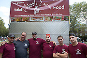 Sammy Kassem, third from left, and his crew from Halal Middle Eastern Food. Kassem won the award for Most Heroic Vendor for his successful struggles with brick-and-mortar merchants in the Bay Ridge community of Brooklyn.