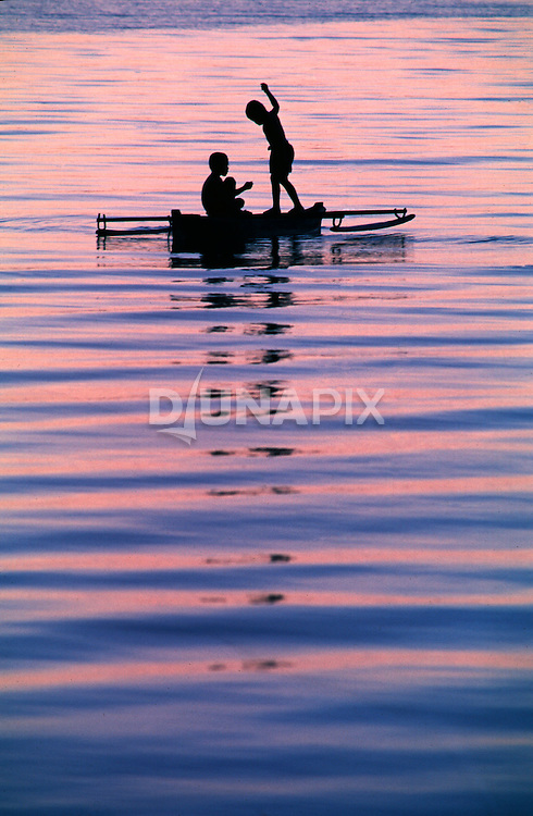 Sawai youngsters on a sunset fishing expedition near Pak Ali's guesthouse.