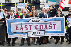 © Licensed to London News Pictures. 18/10/2013. London, UK. Protesters, including Labour Rail Minister, Lilian Greenwood (centre), General Secretary of the National Union of Rail, Maritime and Transport Workers, Bob Crow (2R) and recently arrested Green Part MP Caroline Lucas are at a protest against the re-privatisation of the United Kingdom's East Coast Line in London today (18/10/2013) ahead of handing in a petition consisting of 23,000 commuter's signatures to the transport ministry. The East Coast Line, which runs from London to Scotland, is currently the only publicly owned train line after passing to the government from previous operator National Express who encountered financial difficulties. Photo credit: Matt Cetti-Roberts/LNP