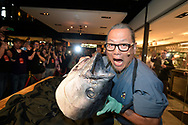 Morimoto Asia Master Chef Masaharu Morimoto displays his precision carving skills, transforming a 100-pound Hawaiian big-eye tuna into a 60-foot maki roll, during a media preview event for the restaurant at Disney Springs, a newly-named entertainment-dining-retail district at the Walt Disney World Resort in Lake Buena Vista, Fla., Tuesday, Sept. 29, 2015. Morimoto Asia, a collaboration of Chef Morimoto and Patina Restaurant Group, is a two-story showplace of dining spaces, exhibition kitchens, open terraces, a sushi bar, the Forbidden Lounge and waterside seating. The event featured Japanese drummers, a weaving, dancing Chinese lion and the traditional breaking of the sake barrel with mallets. (Phelan M. Ebenhack via AP)