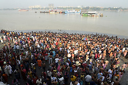October 8, 2018 - Kolkata, West Bengal, India - Hindu devotees gather at the bank of river Ganges to perform rituals to pay homage to their ancestors on the occasion of Mahalaya. Hindu prays an take holy dip in river Ganges to offer homage to their ancestors as they take part in Tarpan a Hindu rituals on the occasion of Mahalaya ahead of Durga Puja Festival. Bengali Hindu observe Mahalaya the last day of Pitri Pakhsha (fortnight if the fore fathers) by paying homage to ancestor in banks of river Ganges. Bengali all over the world will be marking the festival Durga Puja representing the victory of good over evil and the celebration of female power from October 15. (Credit Image: © Saikat Paul/Pacific Press via ZUMA Wire)